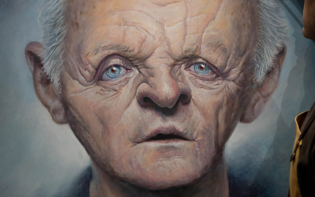Derren Brown adding finishing touches to his portrait of Anthony Hopkins