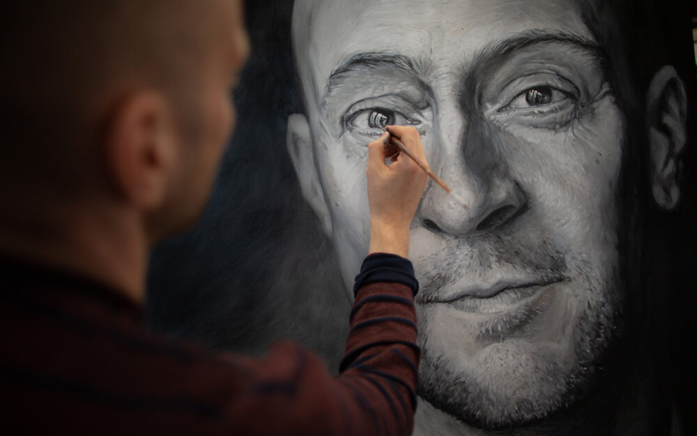 Derren Brown painting a recent self portrait